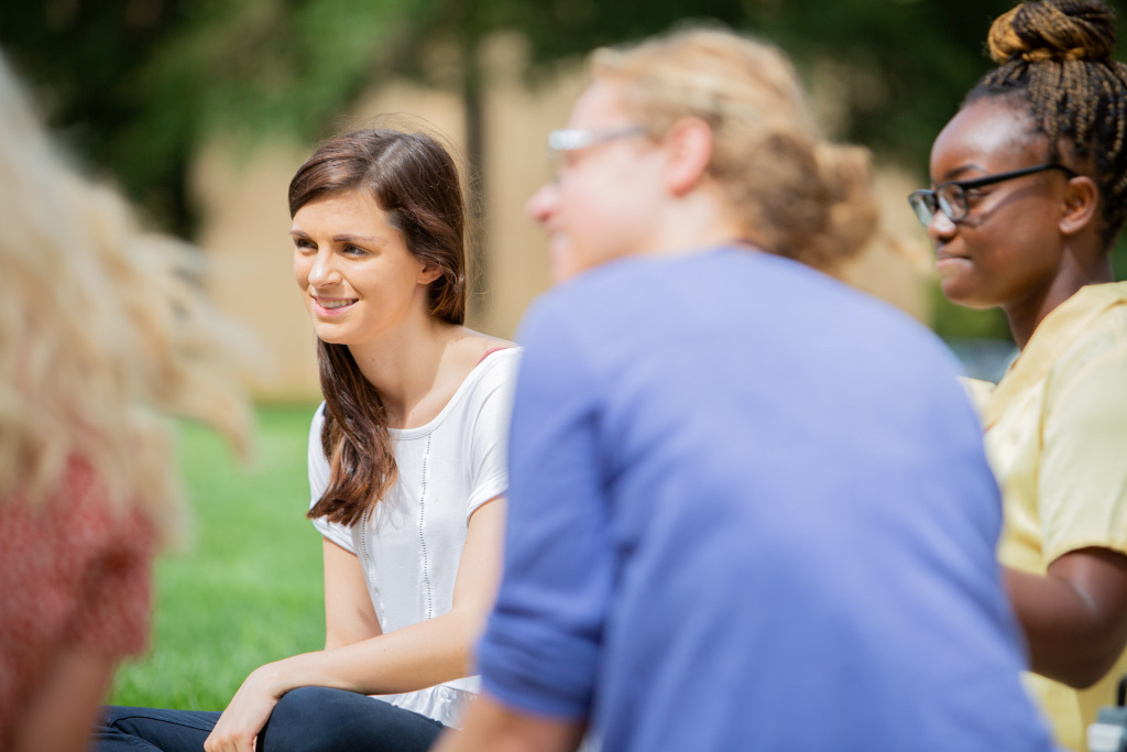 Students study unity in discipleship groups outside